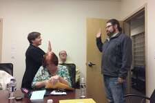 Derby Mayor Anita Dugatto administers the oath of office to Adam Pacheco as a new Housing Authority commissioner on Jan. 4, 2017