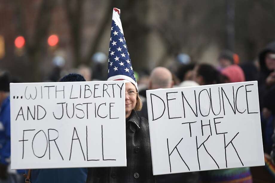 Signs with an anti-KKK message are present during a rally to denounce hate and embrace diversity on Saturday, Dec. 3, 2016, at Townsend Park in Albany, N.Y. The Capital District Coalition Against Islamophobia held the rally in response to the Ku Klux Klan's victory parade in North Carolina to celebrate President-elect Donald Trump's win. (Cindy Schultz / Times Union) Photo: Cindy Schultz, Albany Times Union