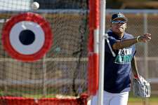 Seattle Mariners starting pitcher Felix Hernandez participates in a drill during spring training baseball practice, Wednesday, Feb. 15, 2017, in Peoria, Ariz. (AP Photo/Charlie Riedel)