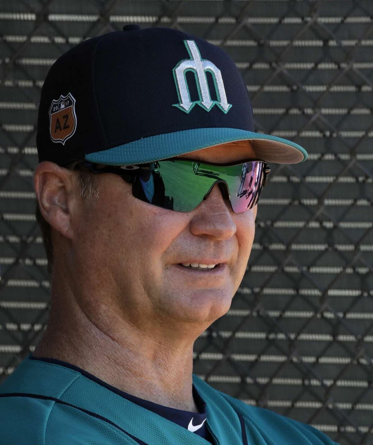 Seattle Mariners manager Scott Servais watches workouts during spring training baseball practice, Wednesday, Feb. 15, 2017, in Peoria, Ariz. (AP Photo/Charlie Riedel)