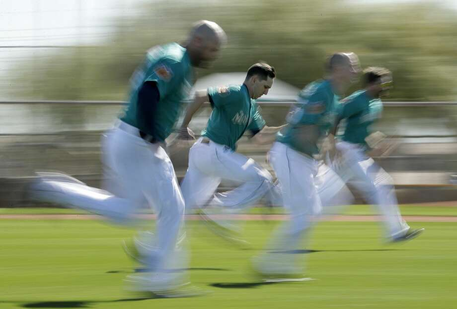 Seattle Mariners players run sprints during spring training baseball practice Wednesday, Feb. 15, 2017, in Peoria, Ariz. (AP Photo/Charlie Riedel) Photo: Charlie Riedel/AP