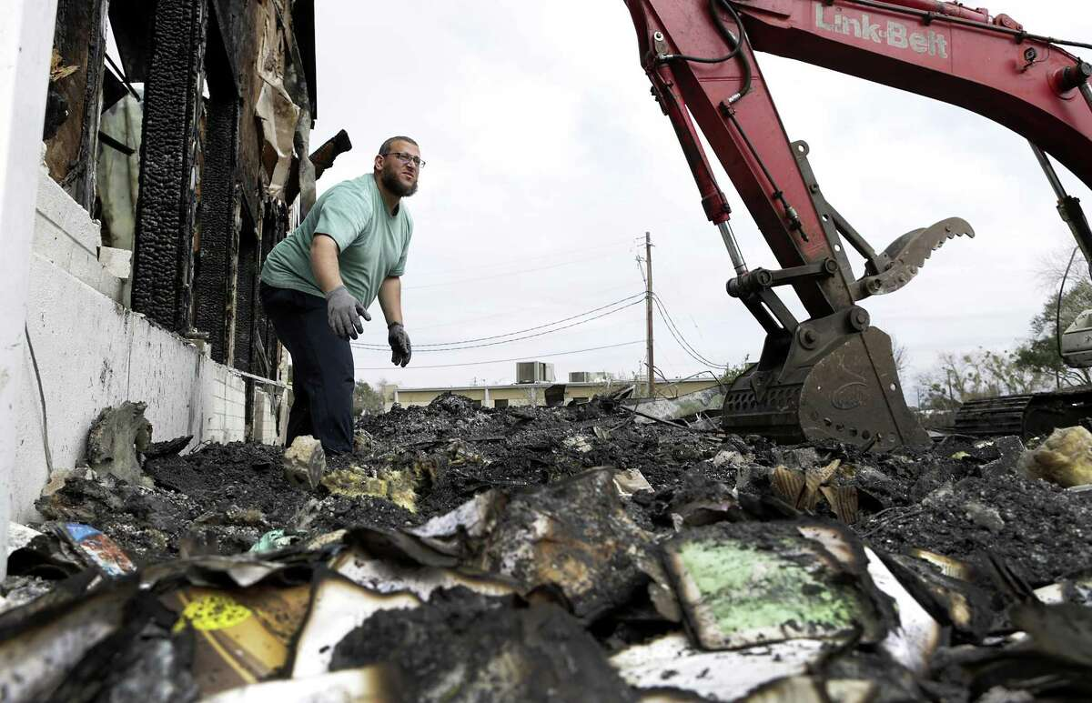 Imam Osama Hassan searches for any parts of Qurans after the total loss of the Victoria Islamic Center, in Victoria, Texas on Tuesday, Feb. 2, 2017. He has discussed with the local fire marshall about burning the damaged books.