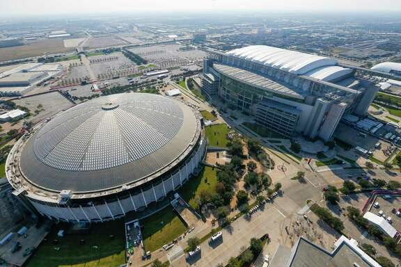 The Astrodome, shown in an aerial view from a Customs and Border Protection helicopter, still has an uncertain future as it sits idle next to NRG Stadium. ( Michael Ciaglo / Houston Chronicle )