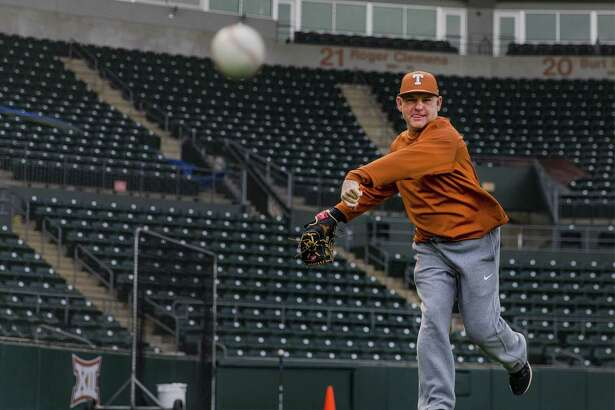 Texas head baseball coach David Pierce warms up during the first practice of the baseball season at UFCU Disch-Falk Field in Austin on Jan. 27, 2017.