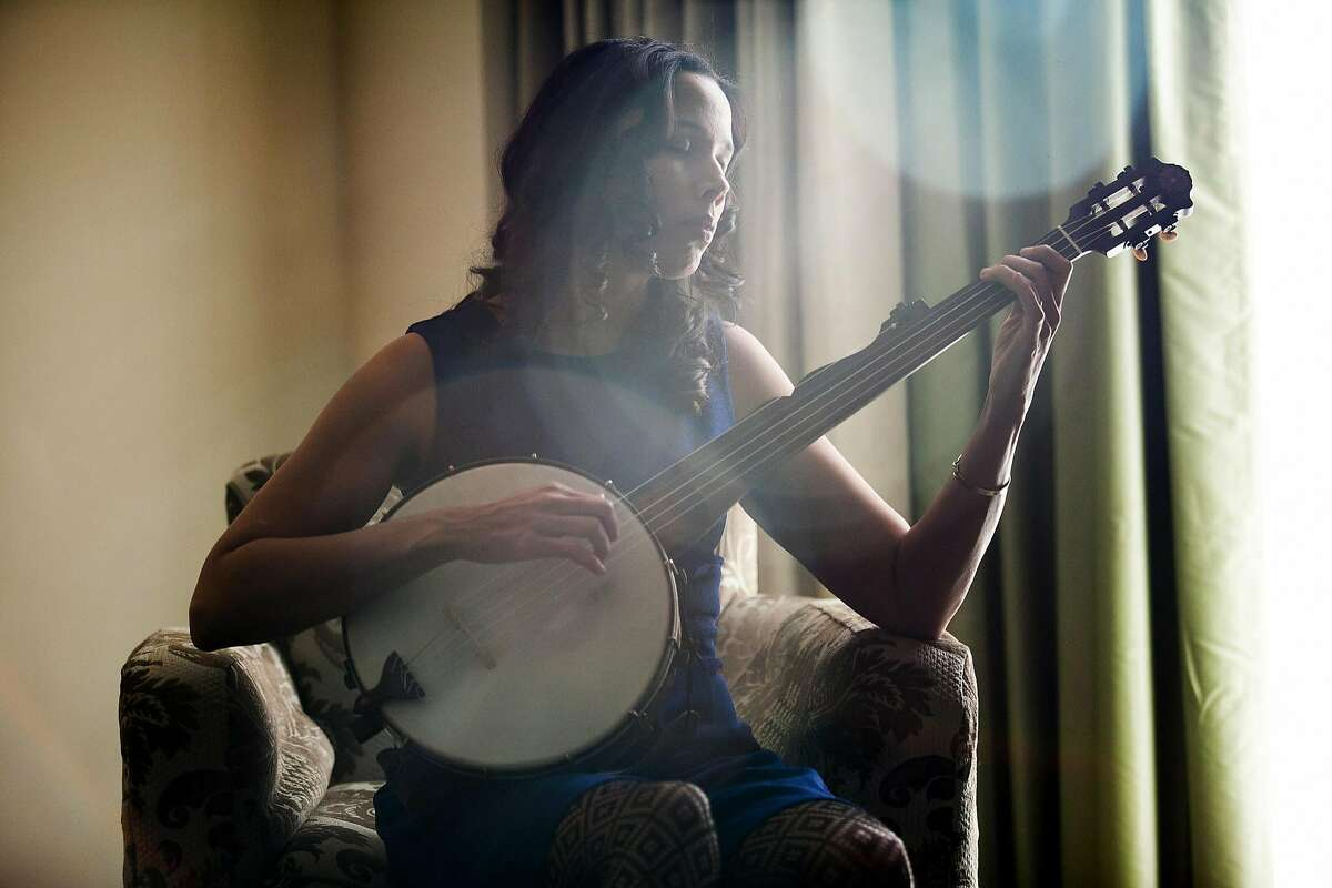 FILE -- Musician Rhiannon Giddens plays her banjo at the Four Seasons hotel in Washington, D.C., Jan 7, 2015. Giddens is the first woman and nonwhite musician to win the Steve Martin Prize for Excellence in Banjo and Bluegrass. (Becky Harlan/The New York Times)