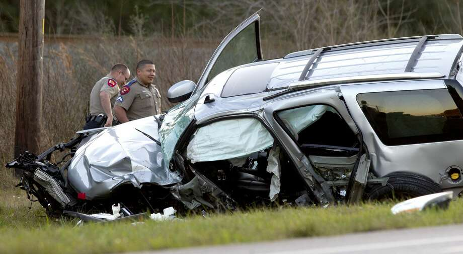 Texas DPS Troopers investigate the scene of a two-vehicle accident that left one person dead and sent two more to the hospital on FM 2854 near Honea Egypt Road Wednesday, Feb. 15, 2017, in Montgomery. Photo: Jason Fochtman/Houston Chronicle