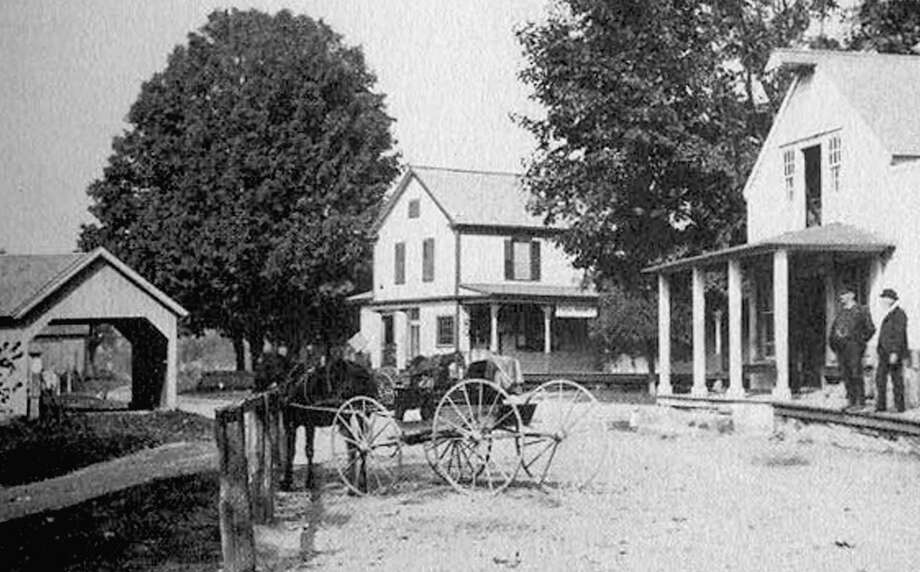 "A view of Gaylordsville's village center circa 1900, with the public scales at the left, Disbrow's store in the center and Barlow's store to the right. If you have a ""Way Back When"" photo you'd like to share, contact Deborah Rose at drose@newmilford.com or call 860-355-7324. Photo: Courtesy Of Howard Peck's ""New Milford"""