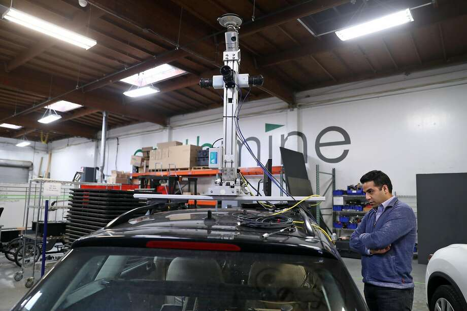 """Sood looks at one of the cars in the company's garage. """"We will deliver the first-ever self-maintaining map,"""" he says. Photo: Scott Strazzante, The Chronicle"""