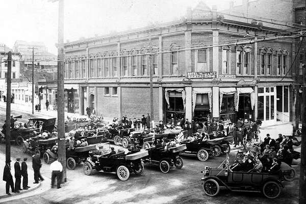 In this 1914 photo, a number of cars stand gathered outside the Delmonico Hotel in downtown Port Townsend. The hotel was housed in the McCurdy Building, built in 1884 and still standing today. Photo courtesy UW Special Collections.