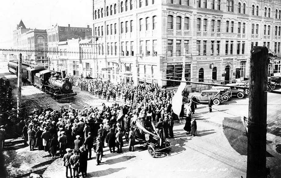 A crowd gathers Oct. 11, 1925 on Water Street at Taylor Street in downtown Port Townsend for the driving of the last spike in the Milwaukee Road extension to Port Townsend's Union Wharf. The extension was celebrated but was to be surpassed by the automobile in just a few years. By the 1930s, the line would be used primarily for freight and timber. Photo courtesy UW Special Collections. Photo: UW Special Collections