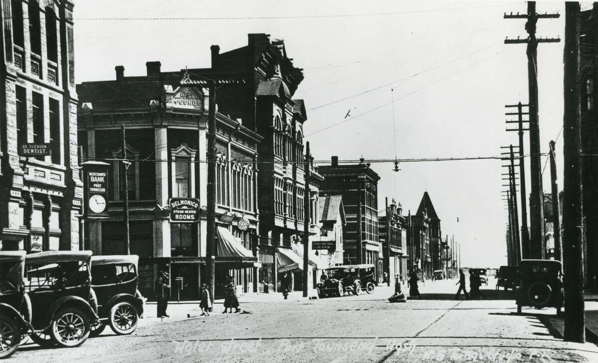 This photo was taken along Port Townsend's main drag downtown, Water Street. The photo is looking east from Taylor Street. The building on the left with the visible
