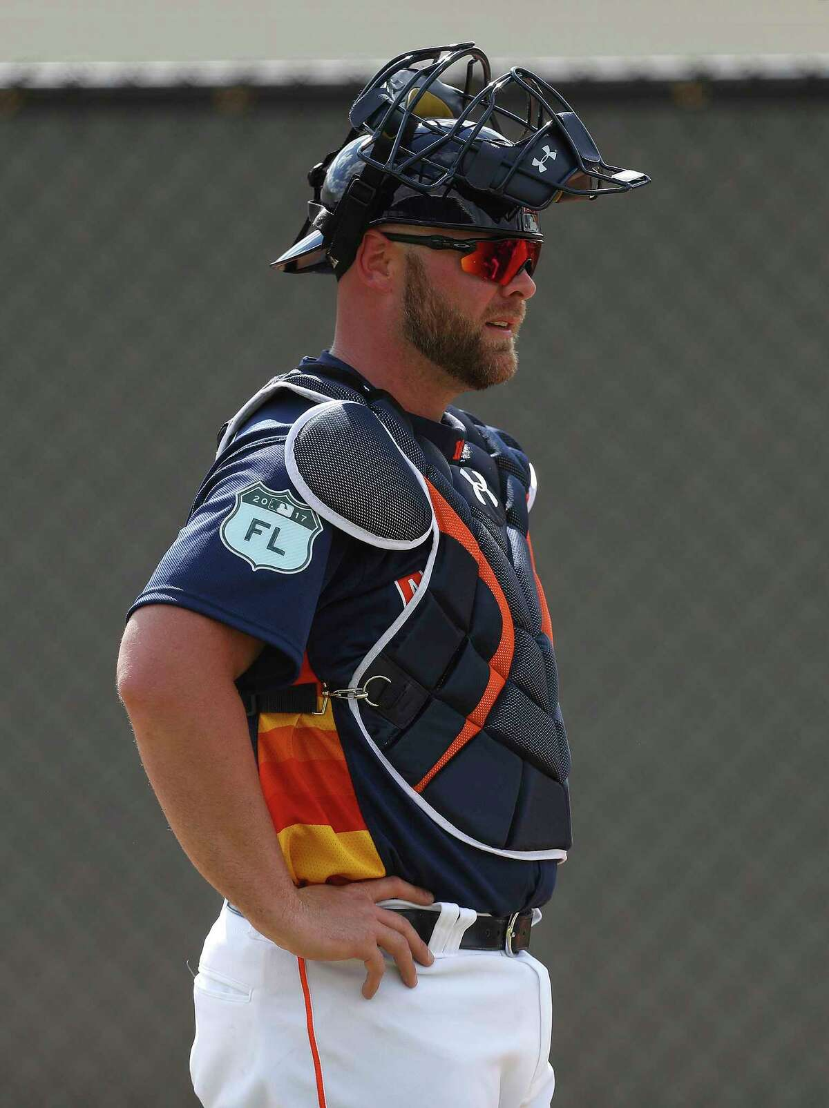 New Astros catcher Brian McCann takes a wait-and-see approach at his first workout.