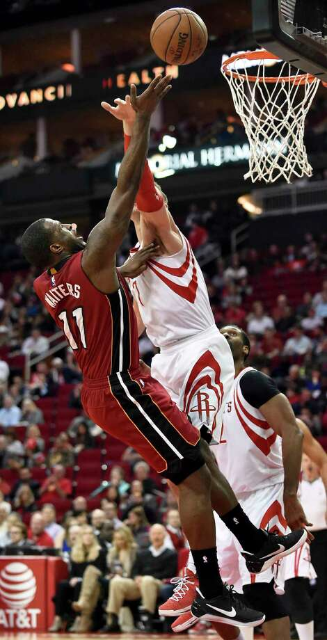 Miami Heat guard Dion Waiters, left, shoots as Houston Rockets forward Sam Dekker defends during the first half of an NBA basketball game, Wednesday in Houston. Photo: Eric Christian Smith, FRE / FR171023 AP