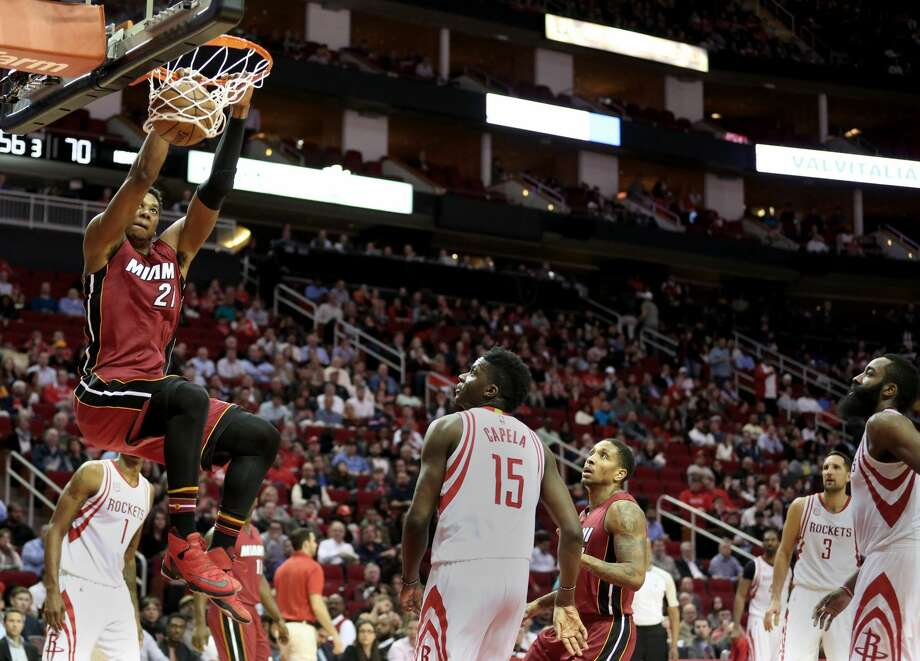 Miami Heat center Hassan Whiteside (21) dunks the ball into the basket during the third quarter of the game Wednesday, Feb. 15, 2017, in Houston. ( Yi-Chin Lee / Houston Chronicle ) Photo: Yi-Chin Lee/Houston Chronicle