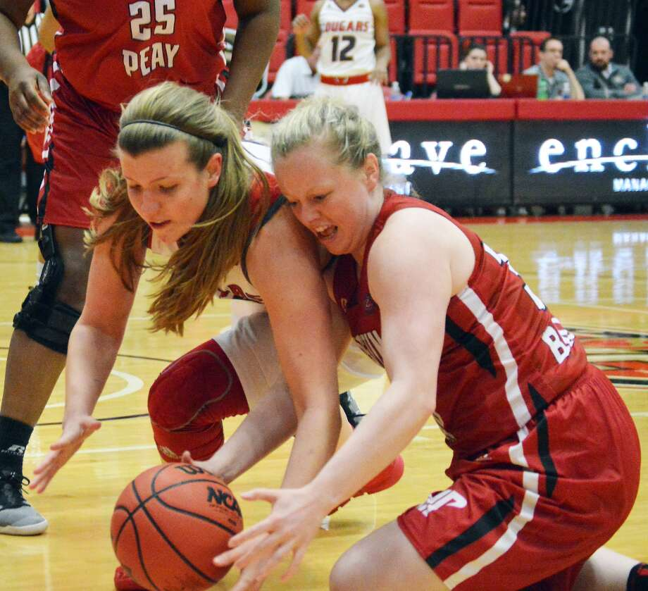 SIUE forward Sydney Bauman, left, tries to grab a loose ball against Austin Peay's Falon Baker during the first quarter of Wednesday's game at the Vadalabene Center.