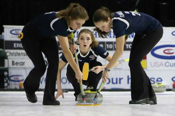 Lexi Lanigan, of Team Bear, looks on as her teammates sweep the ice in front of the rock she threw. Teams compete in the women's division of the 2017 USA Curling National Championships at Xfinity Arena, in Everett, Wednesday, Feb. 15, 2017. The 8-day event begins with round-robin pool plan and end with the finals on Sunday.