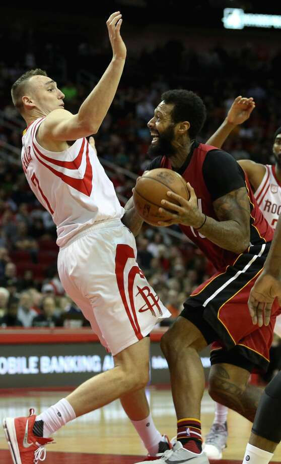 Miami Heat forward James Johnson (16) is called offensive foul on Houston Rockets forward Sam Dekker (7) during the second half of the game Wednesday, Feb. 15, 2017, in Houston. ( Yi-Chin Lee / Houston Chronicle ) Photo: Yi-Chin Lee/Houston Chronicle
