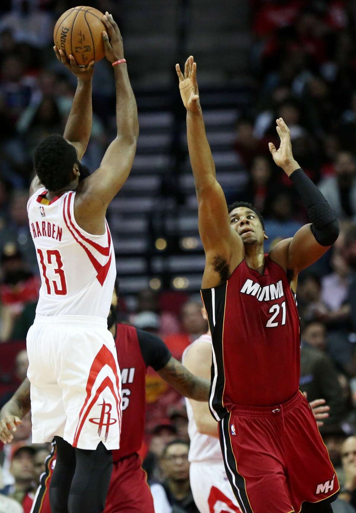 Houston Rockets guard James Harden (13) makes a shot while Miami Heat center Hassan Whiteside (21) tries to block him during the second half of the game Wednesday, Feb. 15, 2017, in Houston. ( Yi-Chin Lee / Houston Chronicle )