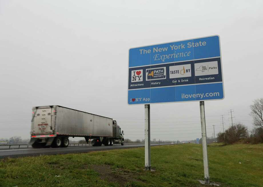 "A truck passes a sign for ""I Love New York"" and other state attractions on the New York State Thruway, Tuesday, Nov. 29, 2016, in Utica, N.Y. Officials with the Federal Highway Administration officials say the signs don't conform to federal standards and pose a dangerous distraction for motorists. (AP Photo/Mike Groll) Photo: Mike Groll / Copyright 2016 The Associated Press. All rights reserved."