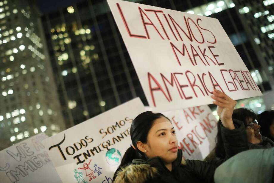"NEW YORK, NY - FEBRUARY 14:  People, many of whom are undocumented, attend a Valentines Day rally organized by the New York Immigration Coalition called ""Love Fights Back"" on February 14, 2017 in New York City. A series of U.S. Immigration and Customs Enforcement (ICE) raids throughout the New York City area last week has sent fears of deportations throughout New York's heavily immigrant communities. According to a 2013 study by the City Planning Commission, nearly 40% of the city's population of 8.2 million is foreign-born. During his campaign President Donald Trump stated that he would deport those with a criminal conviction and in America illegally.  (Photo by Spencer Platt/Getty Images) ORG XMIT: 700001349 ORG XMIT: MER2017021420401919 Photo: Spencer Platt / 2017 Getty Images"