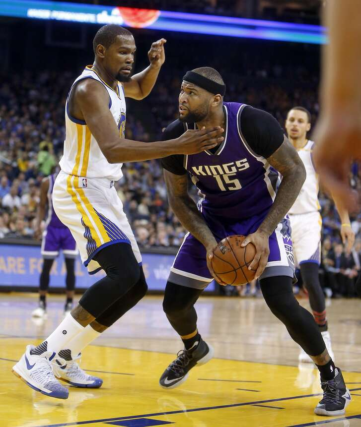 Golden State Warriors' Kevin Durant guards Sacramento Kings' DeMarcus Cousins in 2nd quarter during NBA game at Oracle Arena in Oakalnd, Calif., on Wednesday, February 15, 2017.