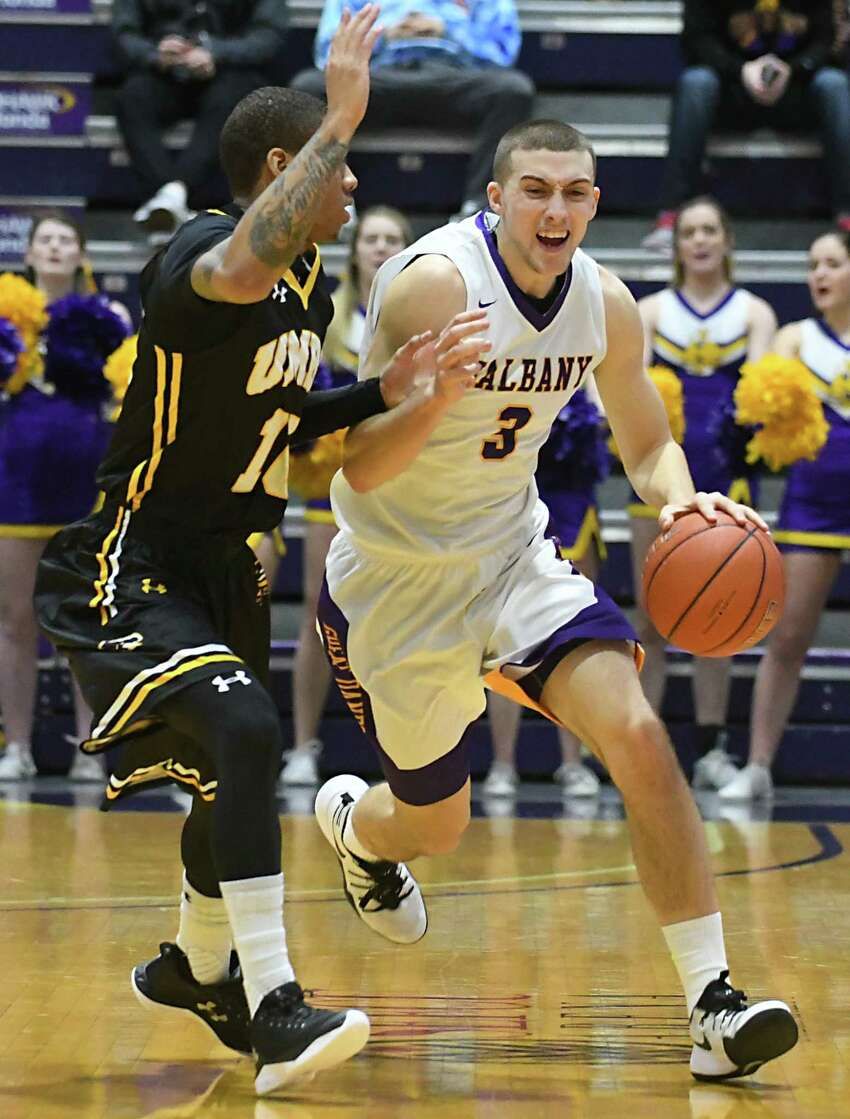 University at Albany's Joe Cremo is defended by UMBC's Jairus Lyles during a basketball game at the SEFCU Arena on Wednesday, Feb. 15, 2017 in Albany, N.Y. (Lori Van Buren / Times Union)