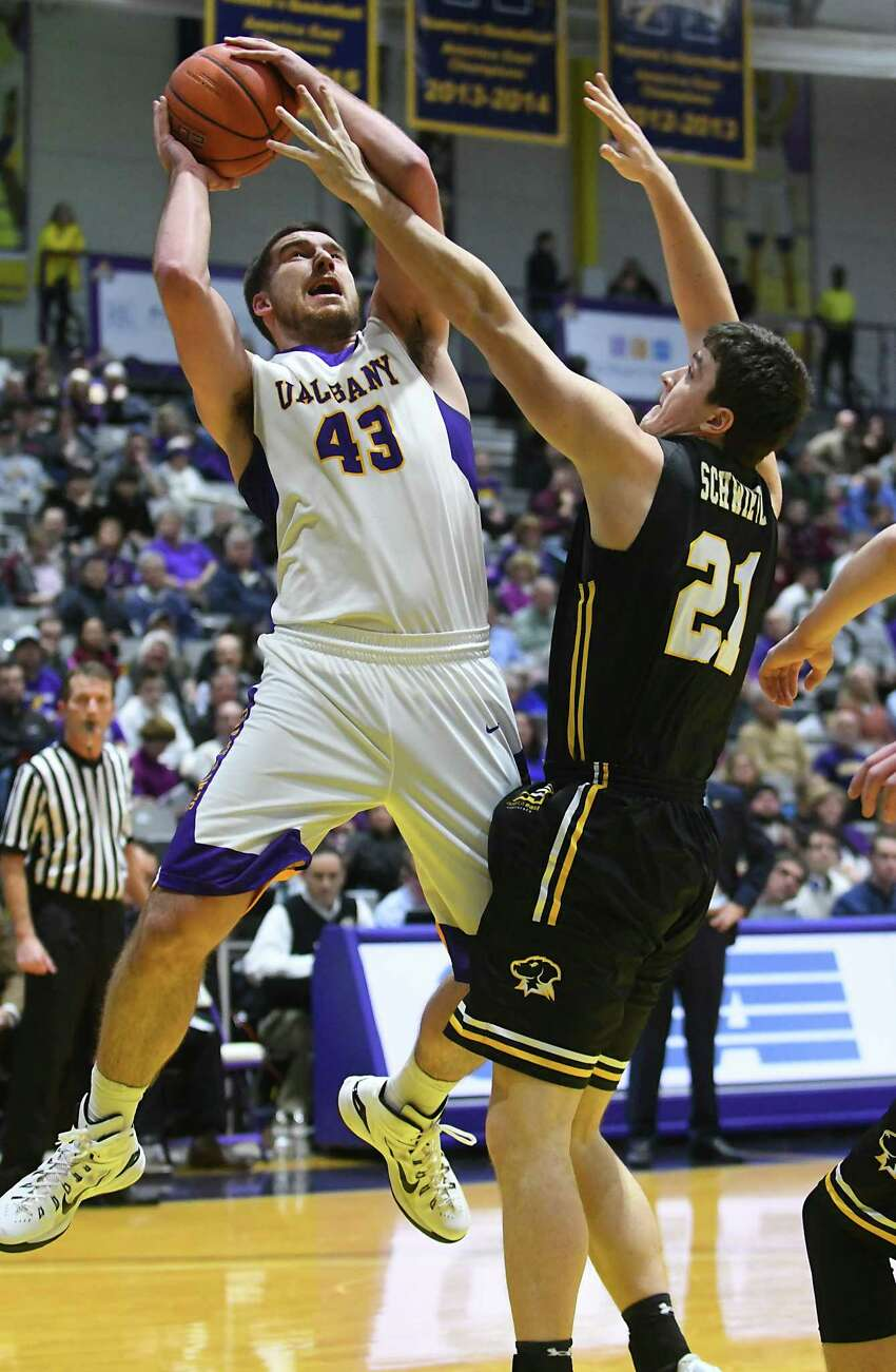 University at Albany's Greig Stire is defended by UMBC's Sam Schwietz as he goes up for a shot during a basketball game at the SEFCU Arena on Wednesday, Feb. 15, 2017 in Albany, N.Y. (Lori Van Buren / Times Union)