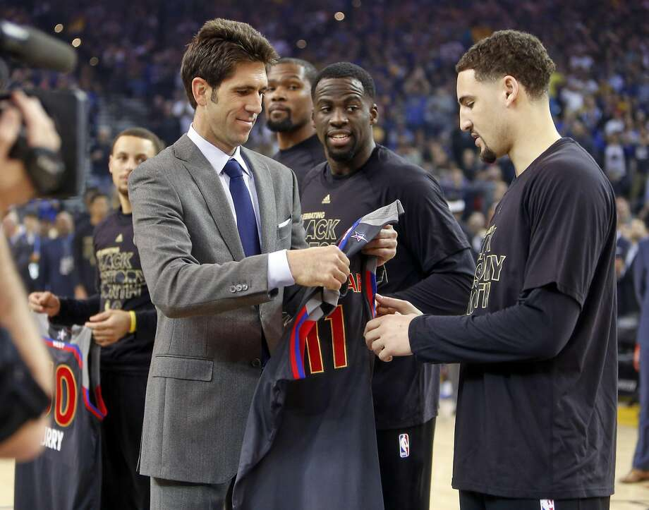 Golden State Warriors' Bob Myers gives Klay Thompson his All-Star Game jersey after Draymond Green, Kevin Durant and Stephen Curry received their jerseys before NBA game against Sacramento Kings at Oracle Arena in Oakalnd, Calif., on Wednesday, February 15, 2017. Photo: Scott Strazzante, The Chronicle