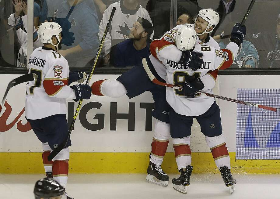Panthers left wing Jonathan Huberdeau (top) celebrates with center Jonathan Marchessault (81) and center Derek MacKenzie (17) after scoring the go-ahead goal in overtime against the Sharks. Photo: Jeff Chiu, Associated Press