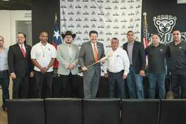 Representatives from the City of Laredo, Laredo Lemurs, Nuevo Laredo Tecolotes and three Mexican League Baseball team pose at Uni-Trade Stadium Wednesday. The group announced that Laredo and Nuevo Laredo will host the first ever Sister Cities Baseball Classic Tournament in March as the Tecolotes face three Mexican Baseball League teams.