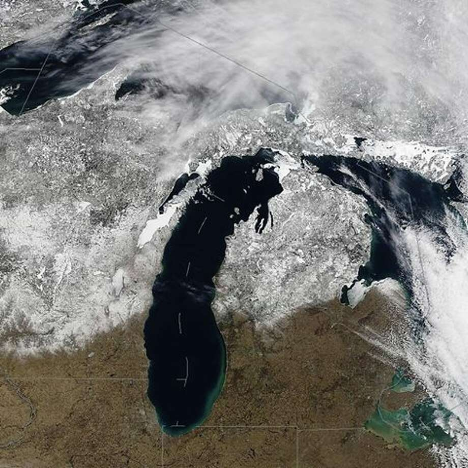 Amazing satellite imagery of the Great Lakes from Monday, Feb. 13. You can see  the ice on the Great Lakes (and/or lack of), ice covered inland lakes,  and drastic difference of snow cover on the ground.....33 inches in  Paradise, Michigan to zero over southern lower Michigan. Photo: National Weather Service Gaylord