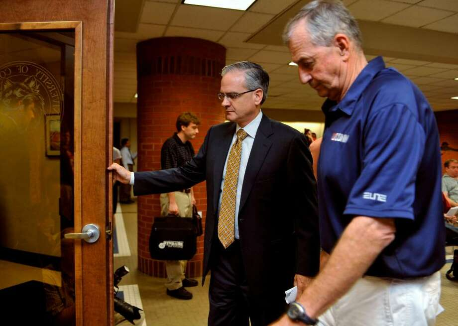 Connecticut basketball head coach Jim Calhoun, right, and Director of Athletics Jeff Hathaway leave a news conference in Storrs, Conn., Friday, May 28, 2010.  The University says the NCAA has found eight violations in the school's men's NCAA college basketball program. (AP Photo/Jessica Hill) Photo: Jessica Hill, AP / AP2010