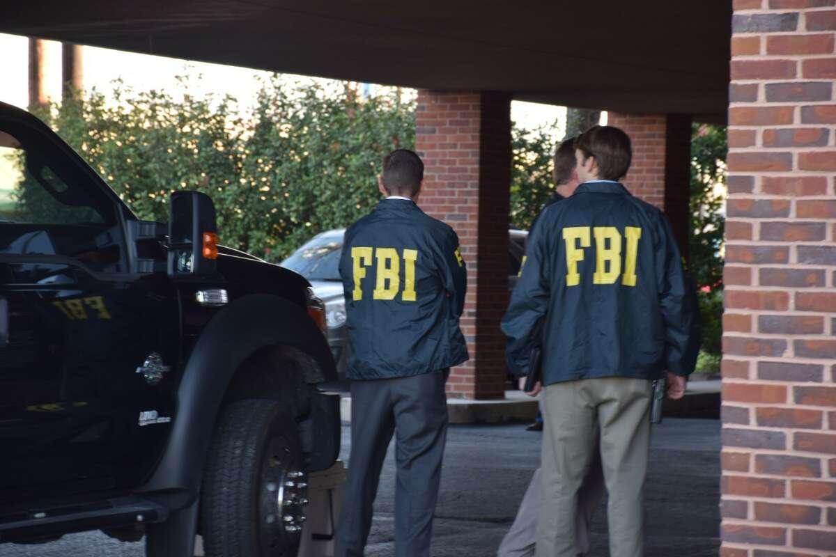The FBI raids the law office of state Sen. Carlos Uresti in San Antonio on Thursday, Feb. 16, 2017.