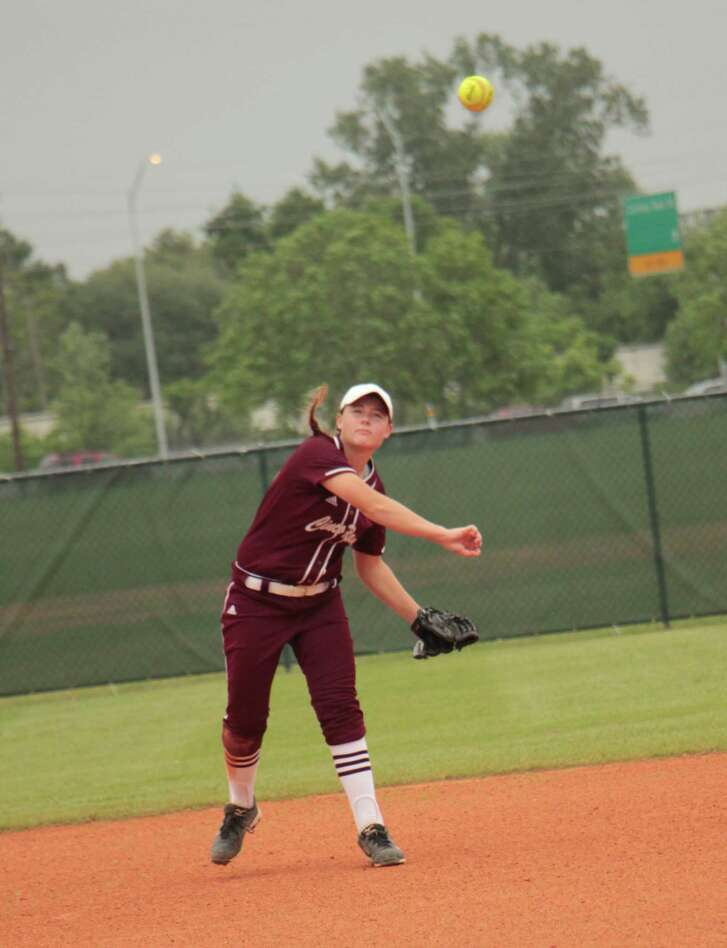 Isabelle McKiernan, short stop for Cinco Ranch throws runner out in a playoff game vs Bellaire at Butler Stadium.
