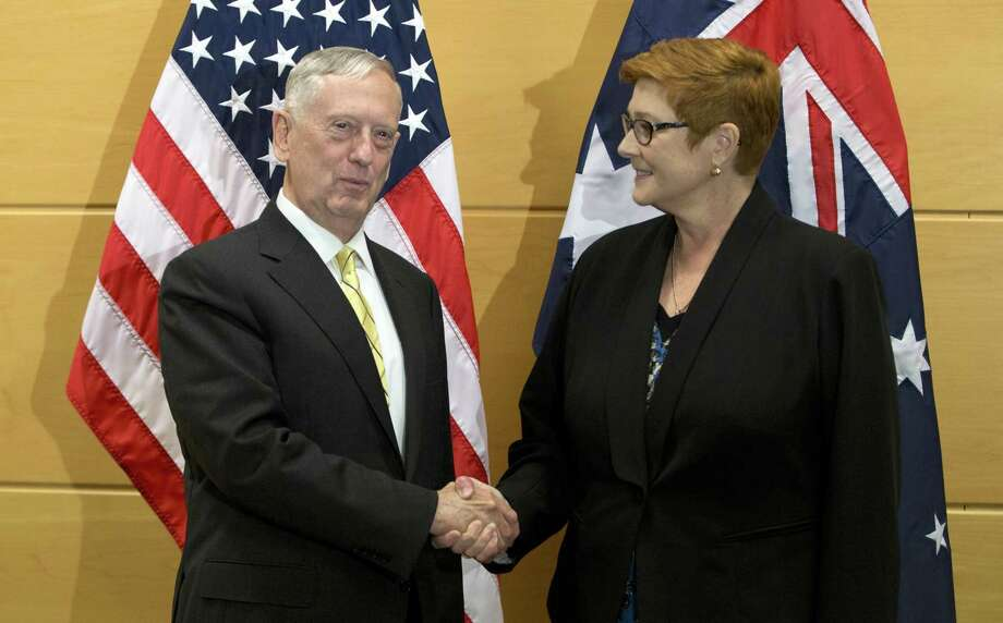 Australia's Defense Minister Marise Payne, right, shakes hands with U.S. Secretary of Defense Jim Mattis prior to a meeting at NATO headquarters in Brussels on Thursday, Feb. 16, 2017. (AP Photo/Virginia Mayo, Pool) Photo: Virginia Mayo, STF / Associated Press / Copyright 2017 The Associated Press. All rights reserved.