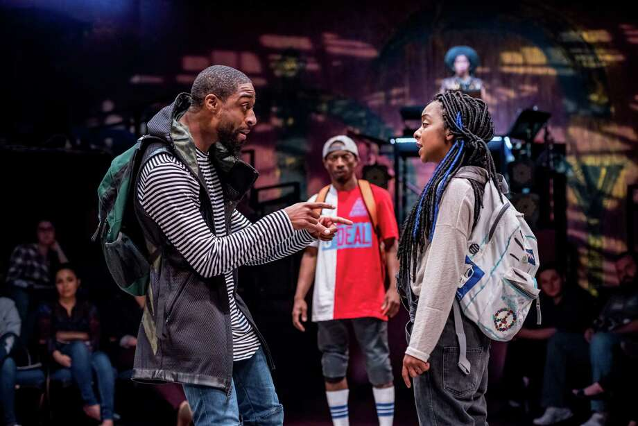 "Nuri Hazzard as Jamal, Elisha Lawson as Ice Cold and and Kara Young as Sweet Tea in the world premiere of ""Syncing Ink"" at the Alley Theatre. The show continues through March 5."