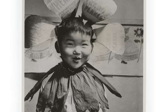 U.S. War Relocation Authority photo of Bob Kaneko of Berkeley as a child in the Topaz, Utah, internment camp. He is wearing a headress made out of cereal boxes.