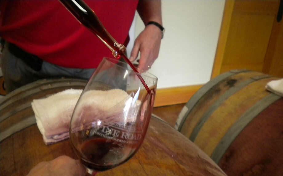 "Using a ""wine thief"" involves dipping a long glass tube with both ends open  to ""steal"" wine from the barrel."