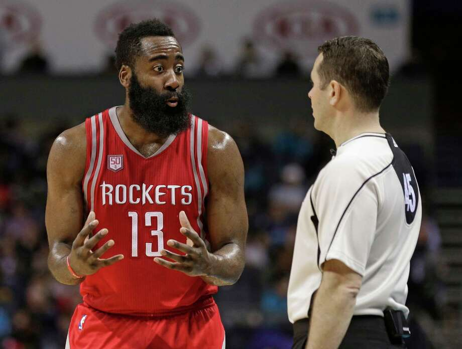 Houston Rockets' James Harden, left, argues a call with official Brian Forte, right, during the second half of the team's NBA basketball game against the Charlotte Hornets in Charlotte, N.C., Thursday, Feb. 9, 2017. The Rockets won 107-95. (AP Photo/Chuck Burton) Photo: Chuck Burton, STF / Copyright 2017 The Associated Press. All rights reserved.