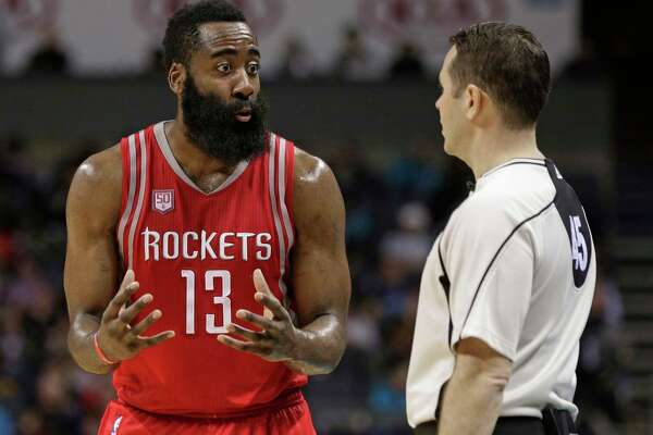 Houston Rockets' James Harden, left, argues a call with official Brian Forte, right, during the second half of the team's NBA basketball game against the Charlotte Hornets in Charlotte, N.C., Thursday, Feb. 9, 2017. The Rockets won 107-95. (AP Photo/Chuck Burton)