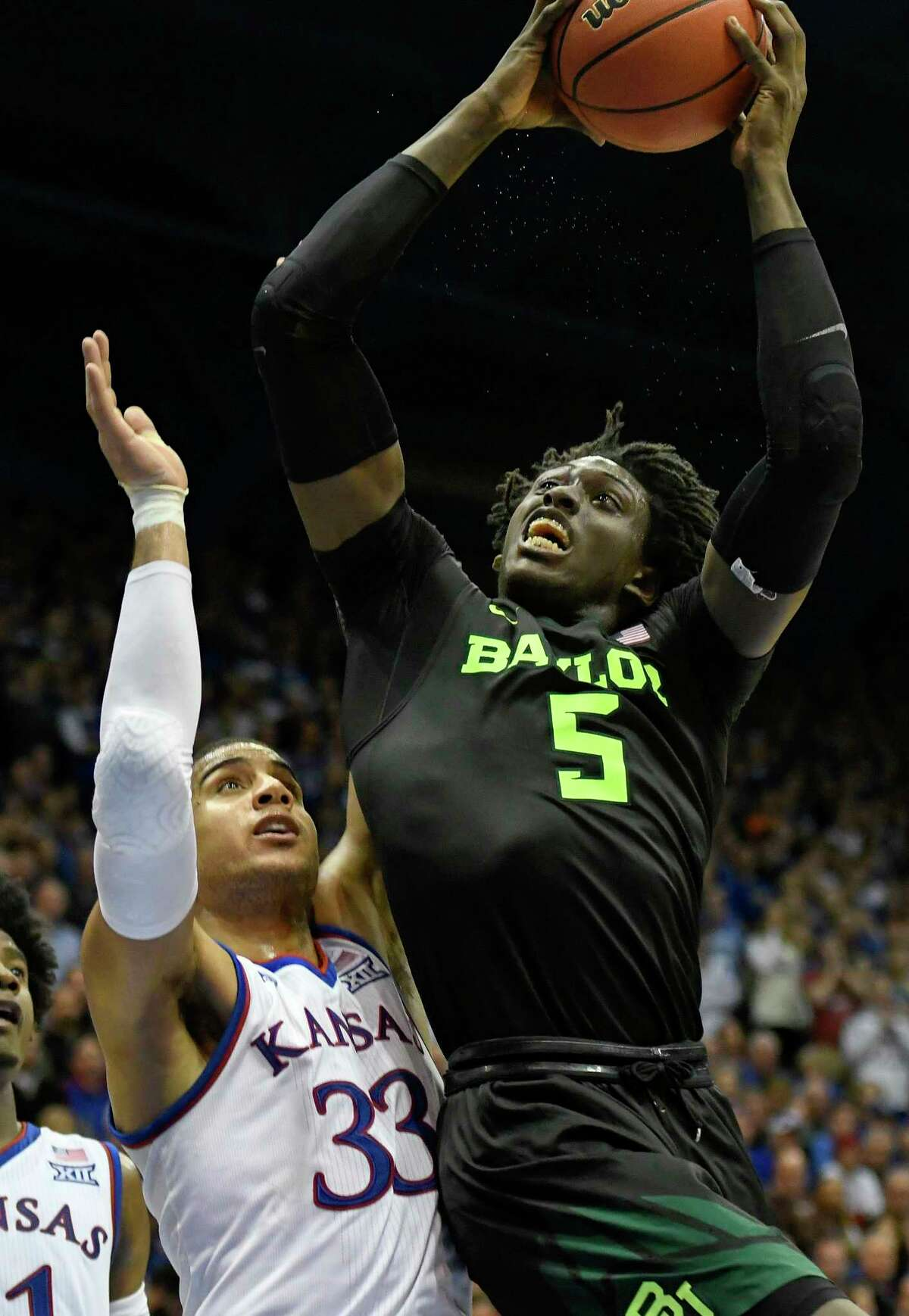 Baylor Bears forward Johnathan Motley (5) goes up for a shot against Kansas Jayhawks forward Landen Lucas (33) during the second half of an NCAA college basketball game in Lawrence, Kan., Wednesday, Feb. 1, 2017. (AP Photo/Reed Hoffmann)