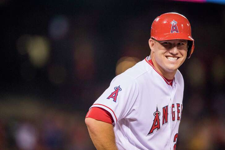 ANAHEIM, CA - AUGUST 16: Mike Trout #27 of the Los Angeles Angels of Anaheim smiles while talking with the Seattle Mariners dugout during the sixth inning of the game at Angel Stadium of Anaheim on August 16, 2016 in Anaheim, California. (Photo by Matt Brown/Angels Baseball LP/Getty Images)