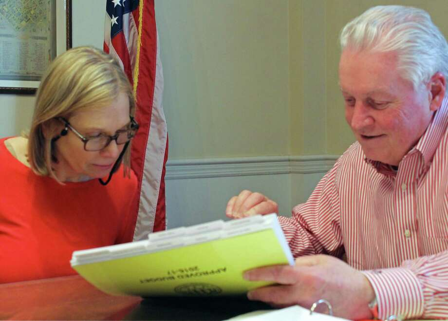 Budget Director Linda Gardiner looks at the current budget with First Selectman Mike Tetreau as Tetreau prepares a new budget that takes into account a significant loss of state revenue. Fairfield,CT. 2/15/17 Photo: Genevieve Reilly / Hearst Connecticut Media / Fairfield Citizen