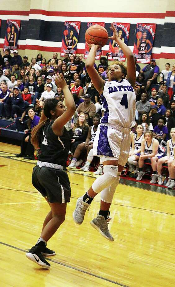 Dayton's Tayelin Grays takes the ball to the hoop in the first-round playoff game against Beaumont Central on Monday night. Grays contributed 40 points in the Lady Broncos upset loss, 78-74. Photo: David Taylor