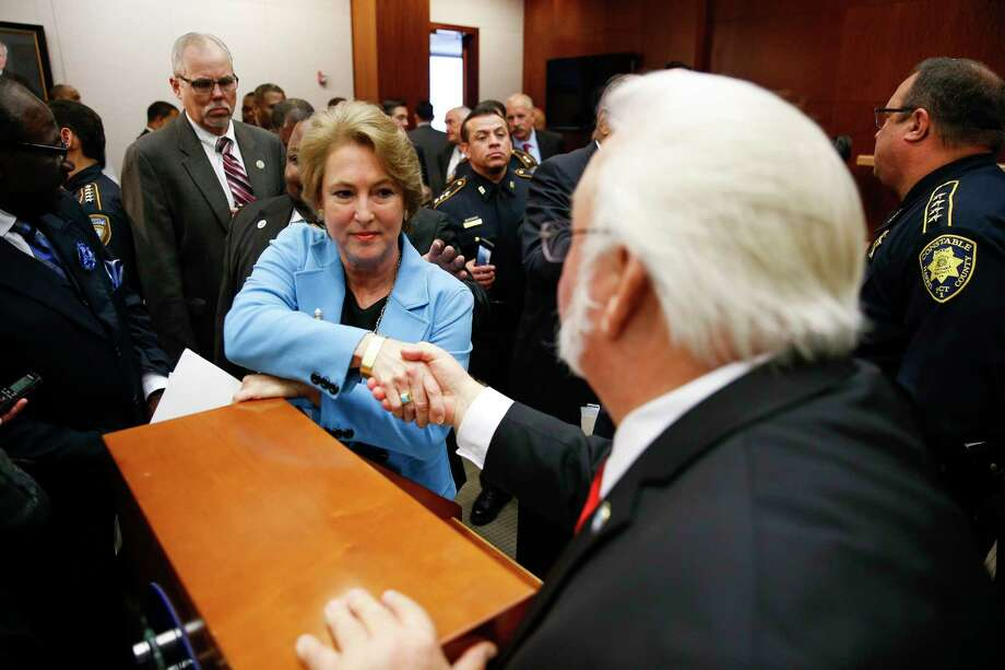 Harris County district attorney Kim Ogg, left, shakes hands with Houston city council member Michael Kubosh, right, after she announced a new policy to decriminalize low-level possession of marijuana Thursday, Feb. 16, 2017 in Houston. The new policy means that most misdemeanor offenders with less than four ounces of marijuana will not be arrested, ticketed or required to appear in court if they agree to take a four-hour drug education class. Photo: Michael Ciaglo, Houston Chronicle / Michael Ciaglo