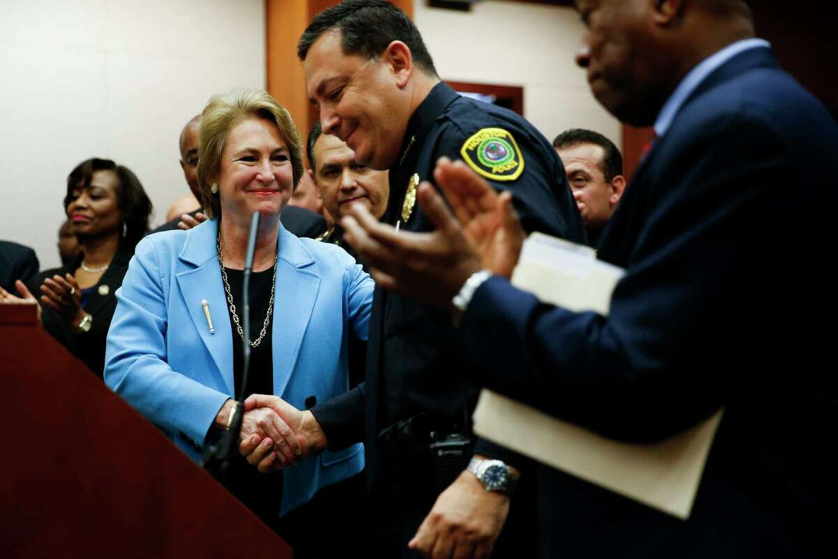 Harris County district attorney Kim Ogg, left, shakes hands with Houston police chief Art Acevedo after she announced a new policy to decriminalize low-level possession of marijuana Thursday, Feb. 16, 2017 in Houston. The new policy means that most misdemeanor offenders with less than four ounces of marijuana will not be arrested, ticketed or required to appear in court if they agree to take a four-hour drug education class.