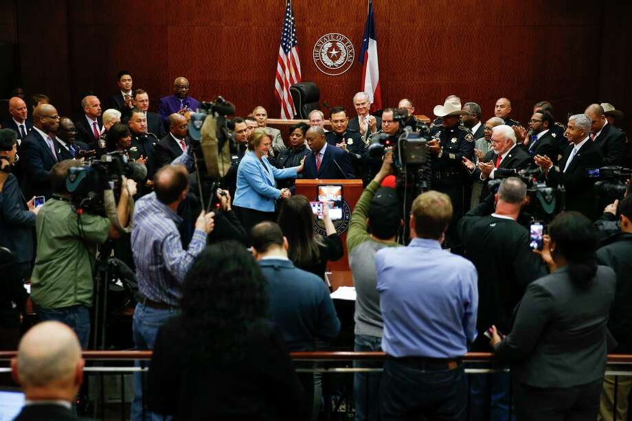 Harris County district attorney Kim Ogg, center left, introduces Houston mayor Sylvester Turner, center, after she announced a new policy to decriminalize low-level possession of marijuana Thursday, Feb. 16, 2017 in Houston. The new policy means that most misdemeanor offenders with less than four ounces of marijuana will not be arrested, ticketed or required to appear in court if they agree to take a four-hour drug education class. Photo: Michael Ciaglo, Houston Chronicle / Michael Ciaglo