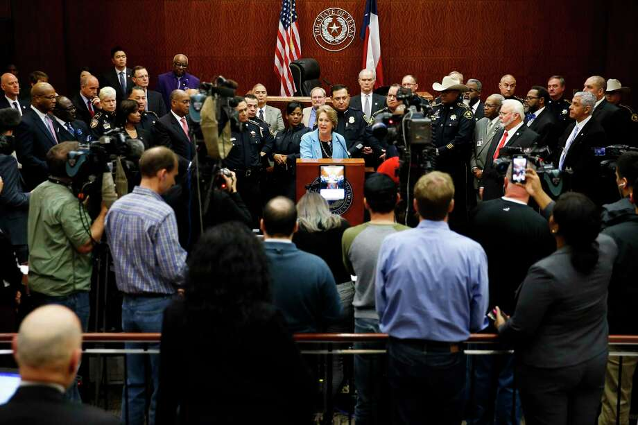 Harris County district attorney Kim Ogg announces a new policy to decriminalize low-level possession of marijuana Thursday, Feb. 16, 2017 in Houston. The new policy means that most misdemeanor offenders with less than four ounces of marijuana will not be arrested, ticketed or required to appear in court if they agree to take a four-hour drug education class. Photo: Michael Ciaglo, Houston Chronicle / Michael Ciaglo