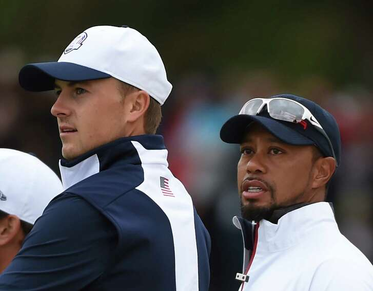 Team USA player Jordan Spieth and Vice-Captain Tiger Woods attend a practice round ahead of the 41st Ryder Cup at Hazeltine National Golf Course in Chaska, Minnesota, September 28, 2016 / AFP / TIMOTHY A. CLARY (Photo credit should read TIMOTHY A. CLARY/AFP/Getty Images)