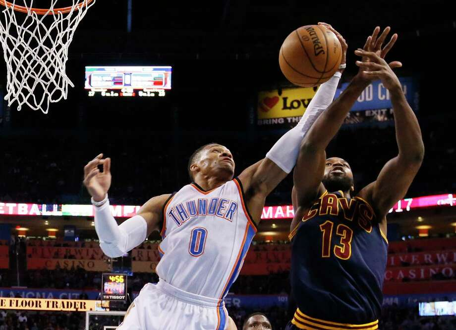 Oklahoma City Thunder guard Russell Westbrook (0) grabs a rebound in front of Cleveland Cavaliers center Tristan Thompson (13) in the first quarter of an NBA basketball game in Oklahoma City, Thursday, Feb. 9, 2017. (AP Photo/Sue Ogrocki) Photo: Sue Ogrocki, STF / AP2017